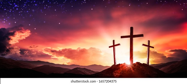 Three Wooden Crosses At Sunrise With Clouds And Starry Sky Background