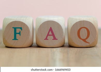 Three wooden cubes with the letters F A Q