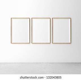 three wooden frames on wall