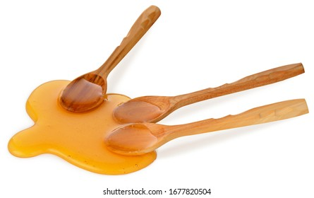 Three wooden spoon with yellow liquid natural honey isolated on white background