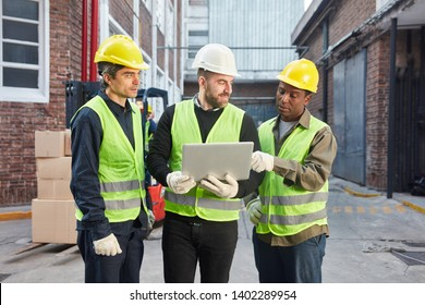 Three workers using laptop as a logistics team are planning a delivery in teamwork