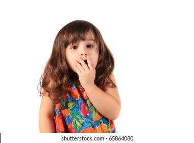 Three year old brunette caucasian girl with surprised, or scared look on her face on a white background