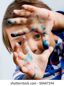 Three year old child with painted fingers