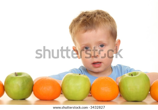 three years old boy playing with fruits isolated on white