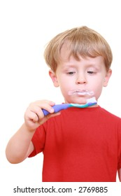 three years old boy with tooth-brush and toothpaste isolated on white