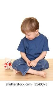 three years old boysand his teddy bear friend isolated on white