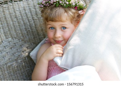 Three years old bridesmaid with wreath on the head