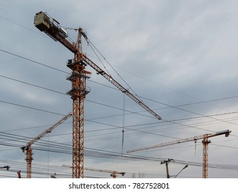 three yellow construction crane against blue sky