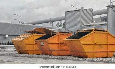 Three yellow industrial waste bin (dumpster) in power plant, Color Splash