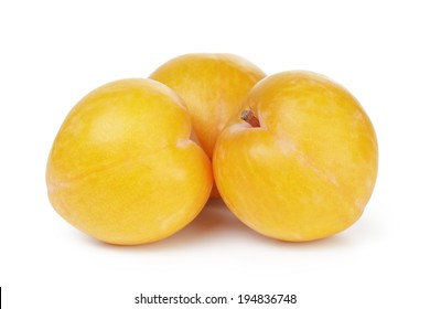 three yellow plums, isolated on white background