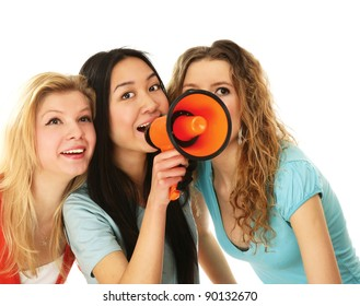 Three yong girls making announcement isolated on white background