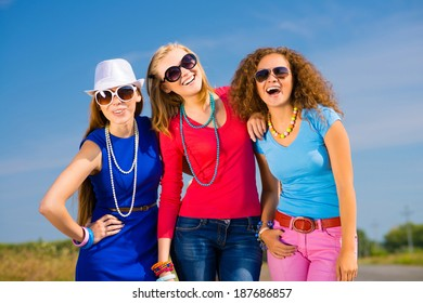 three young attractive girls having fun together, spend fun time with friends