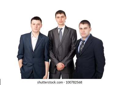 Three young business men standing isolated on white background