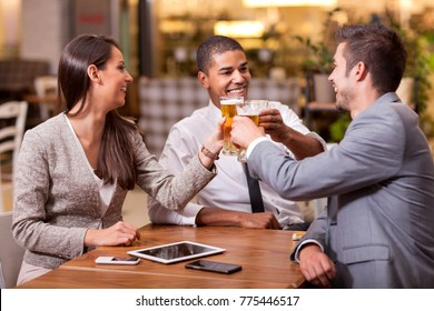 Three young businessmen toasting their success