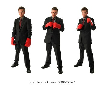Three young businessmen wearing boxing gloves isolated on white