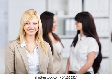 three young businesswomen talking in the office