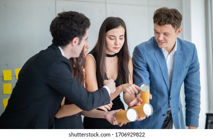 three Young Creative People brainstorming on Trial products