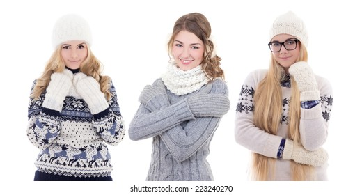 three young cute women in warm winter clothes isolated on white background