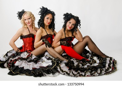 Three young girls dancing in studio a french cancan