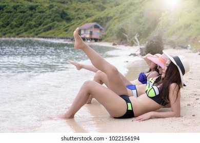 Three young girls friend relaxing on the beach.island lifestyle. Vacation at paradise. Ocean beach relax, travel to Maldives islands. Holiday fashion concept.