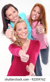 Three young girls gesturing thumb up sign