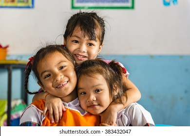 Three young girls girlfriends in a thai school. Thai school in a small village