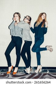 Three young girls  having fun. Trendy teenagers posing hipsters Toned
