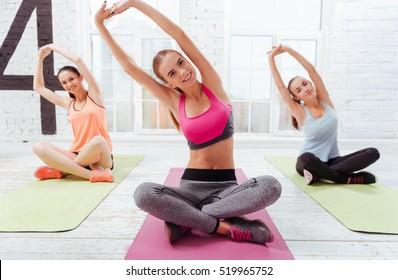 Three young girls having morning yoga