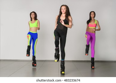 Three young girls jumping on kangoo training