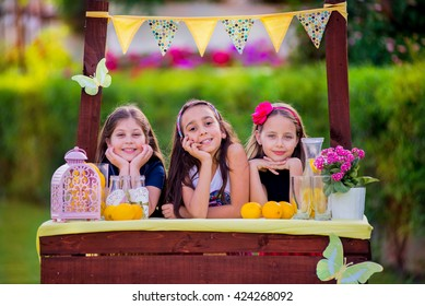 Three young girls at their lemonade stand