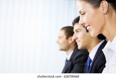 Three young happy successful businesspeople working at office. Blank copyspace area for slogan, advertisiment or text. Success in business and teamwork concept.