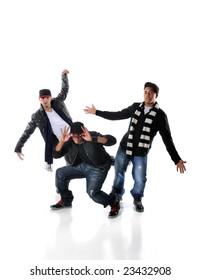 Three young men dancing hip hop moves