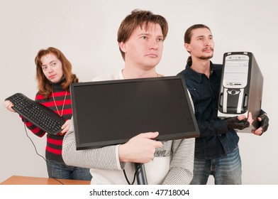 Three young men also hold the new computer.