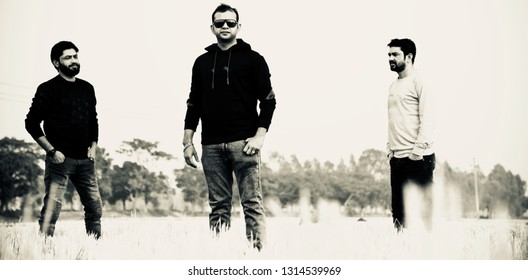 Three young men standing around a place unique black and white photo