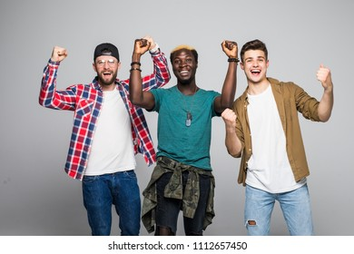 Three young mixed race men with victory sign isolated on white background
