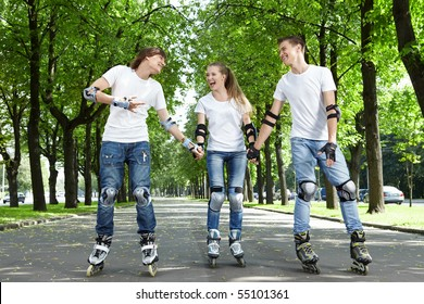 Three young people go for a drive on rollers