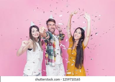 Three young people on a New Year's eve party