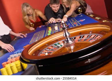 Three young people playing roulette