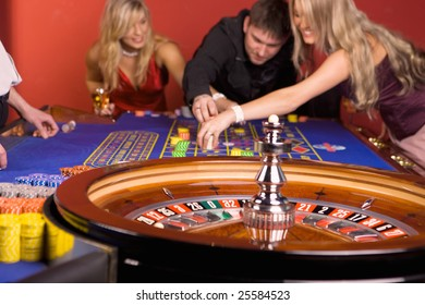 Three young people playing roulette 3