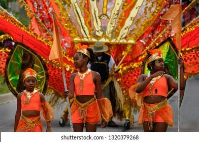 Three young revelers in orange at the Junior Caribana Parade in Toronto, Ontario, Canada - July 19, 2008