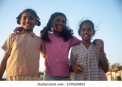 india slum girl three young Slum girls Playing outside home in Malabar hill area Mumbai  city Maharashtra state India