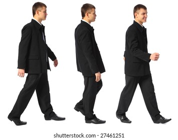 three young smiling businessmen walks