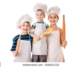 Three young smiling chefs standing together with ladle and rolling pin, isolated on white