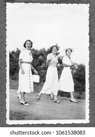 Three young smiling women in 1934. Black And White