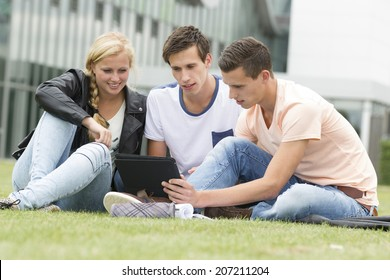 Three young student watching something on an Ipad
