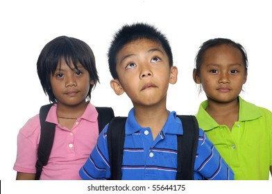 Three young students with books, folders and rucksack for school.