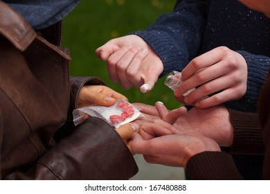 Three young students trying differents types of drugs