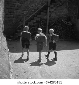 Three young students walking with backpacks