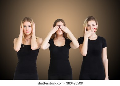 Three young woman in black clothes isolated at brown background showing blind, deaf and dumb: wise monkey scene - hear no evil, see no evil, speak no evil