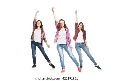 three young women dancing over white background